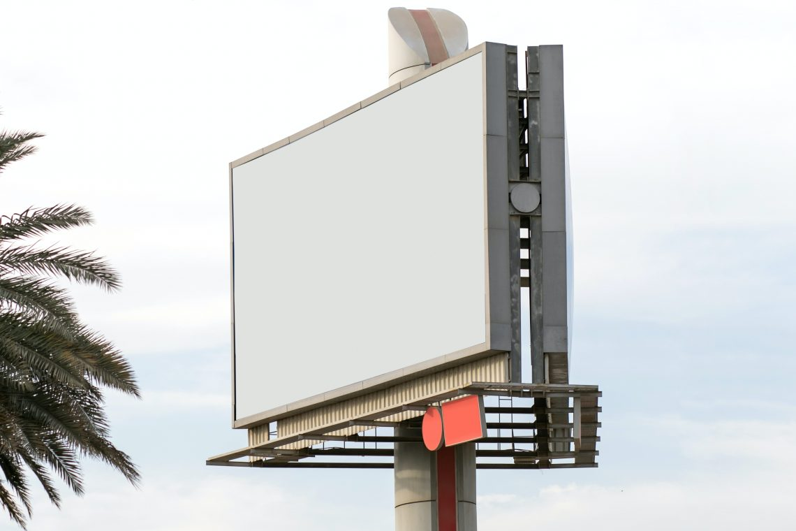 In the image, a blank billboard sits waiting - open for an advertising opportunity.