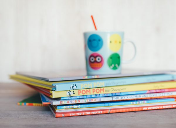 A stack of brightly colored children's books.